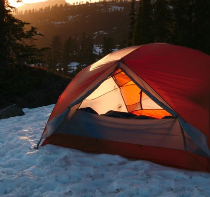 setting up a tent on the snow